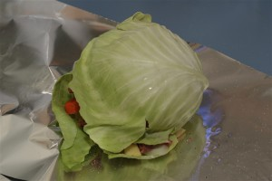 Top your stew with another cabbage leaf to cover the meat and other vegetables.